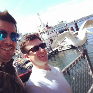 On the Ivar's patio at Seattle Pier 54 with Clint and a friendly seagull, August 2014.