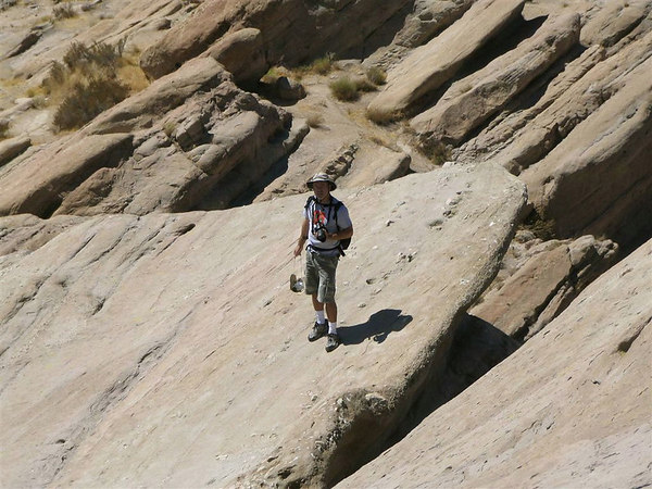 Standing on one of the rock formations at Vasquez Rocks County Park