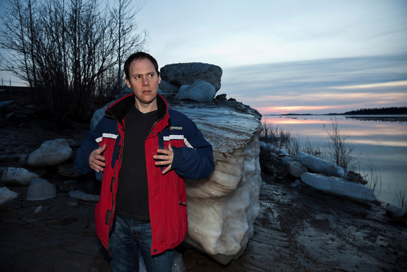 Canadian tenor Bud Roach on the shore of the Moose River at Moosonee, Ontario at sunrise 2009 May 6th. Mr. Roach was in Moosonee for the Northern Ontario Tour of the Cree Opera Pimootweein which was presented in Moosonee 2009 May 5th.