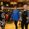 Budget Buddies celebrates its 10-year anniversary, honoring retiring co-founders Anita Saville, right, and Kathy Brough, center, both of Chelmsford, and introducing new executive director Danielle Piskadlo of Acton, left, dancing to some very loud music. (SUN/Julia Malakie)