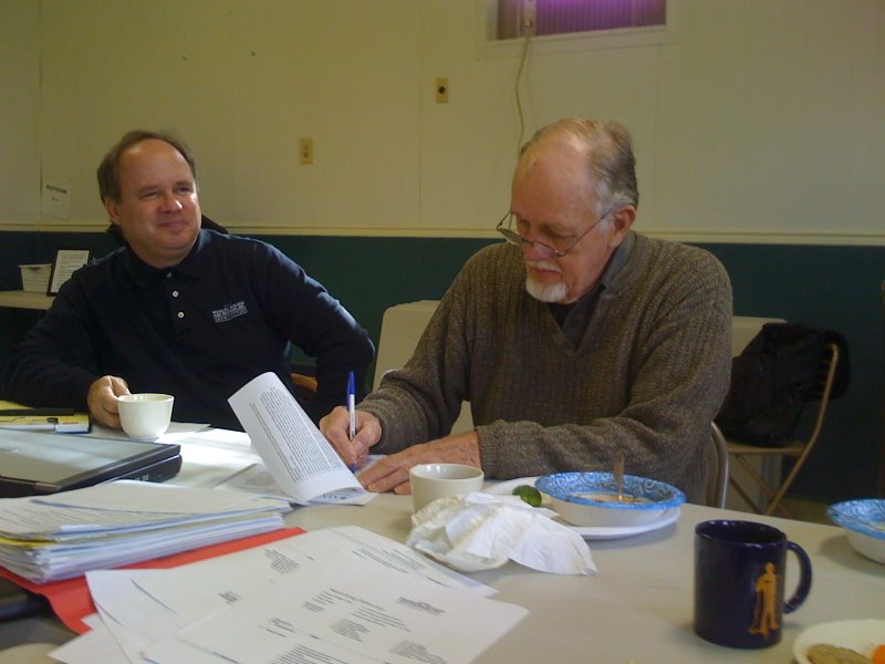 November 23, 2008 - Verne, co-chair of the Building Committee, signs the contract with Woollen-Molzan while our principle architect, Kevin Huse, looks on.