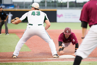CMU's Kyle Serrano dives back to first during the Division II College World Series at Airhogs Stadium in Grand Prairie Texas.