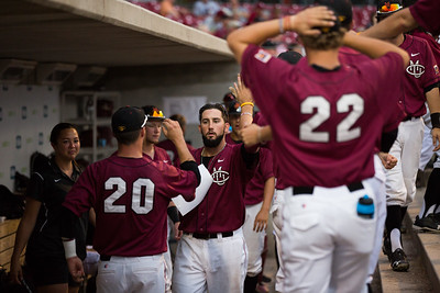 CMU's Matt Haggerty celebrates in the dugout during the Division II College World Series at Airhogs Stadium in Grand Prairie Texas.