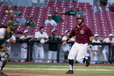 CMU's Matt Haggerty scores in the third inning during the Division II College World Series at Airhogs Stadium in Grand Prairie Texas.