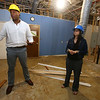 CTI director of youth services Amanda Mallardo, and division director for housing & homeless services Carl Howell, in the space in CTI's Dutton Street building that will become Mill You. (SUN/Julia Malakie)