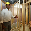CTI division director for housing & homeless services Carl Howell, in space that will be a laundry, showers and toilets, as part of Mill You, to help homeless youth. (SUN/Julia Malakie)