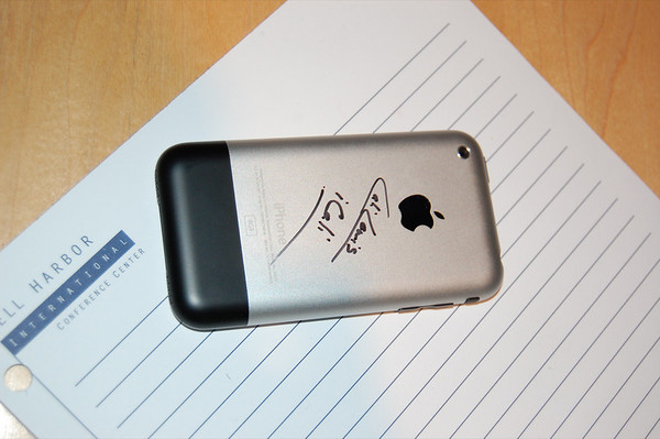 I Signed an iPhone!!!!????!!!!  Here is the iPhone Matthew Miller, ZDNet's Mobile Gadgeteer asked me to sign.  He crazy! :)
