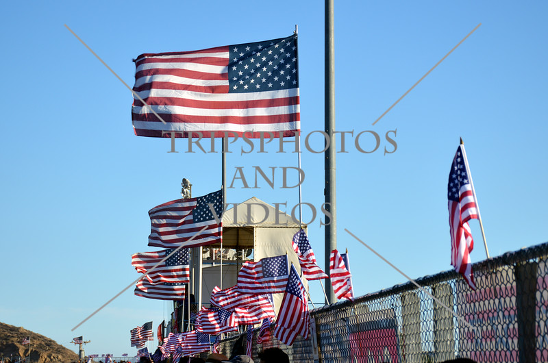 US flags wave over the grandstand at the auto speedway in Perris, California.