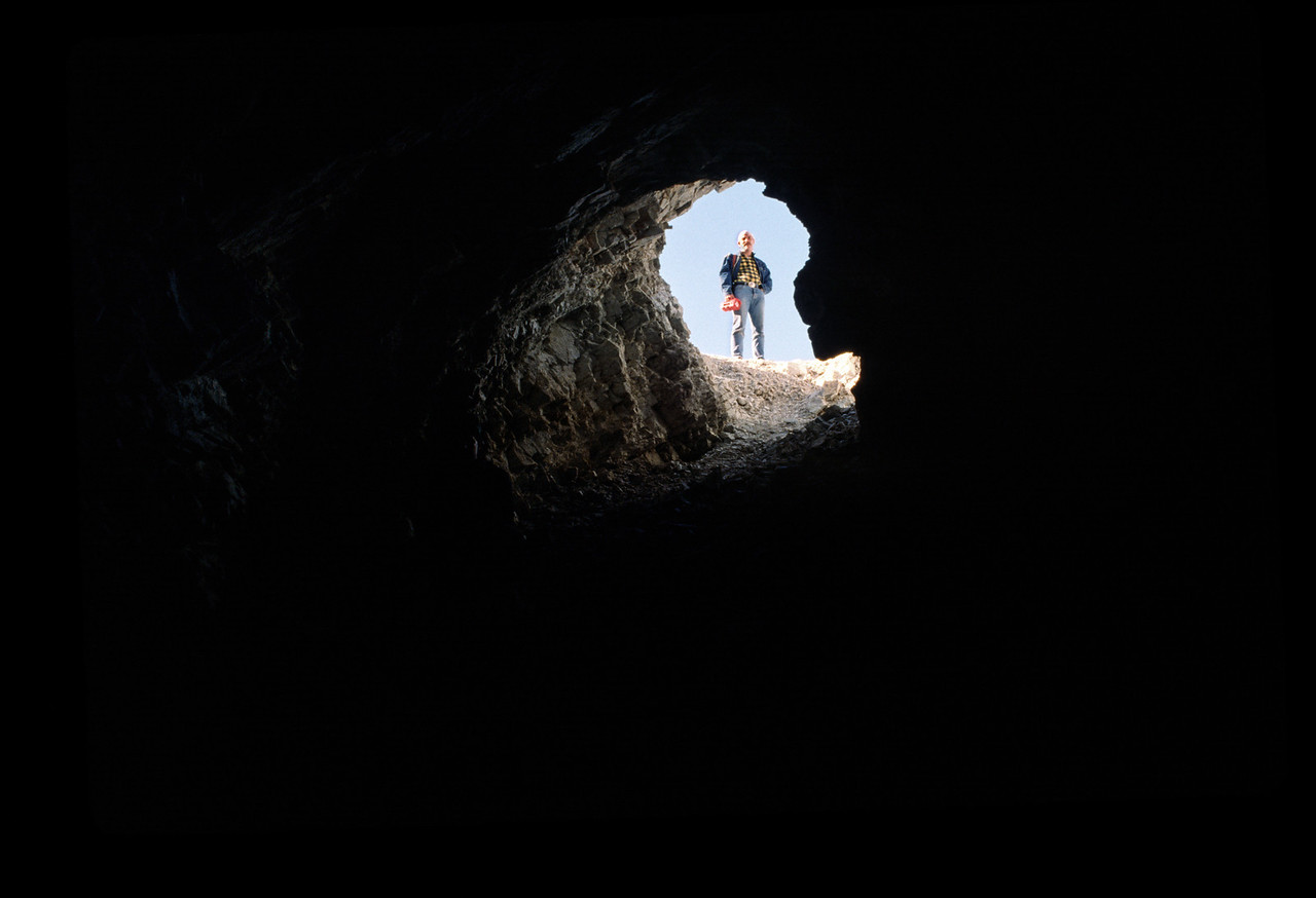 Looking up at Michael Coffman from a mud-hill cave - Anza-Borrego 1989