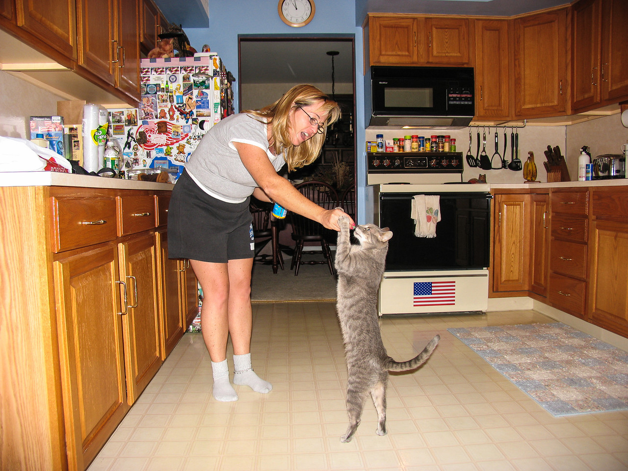 Gina giving El Gato some snacks - August 2005