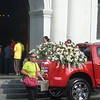 This red vehicle is waiting outside the Cebu Cathedral for the official image of Pedro Calungsod. The vehicles takes the image to the Mactan-Cebu International Airport.  The image was flown to Rome on October 16, 2012. (Sunnex)