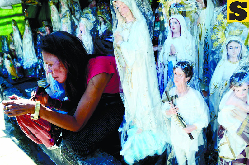 Vendors along D. Jakosalem street, Cebu City start selling images of Blessed Pedro Calungsod. (Sun.Star Photo/Amper Campaña)