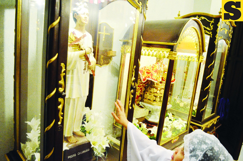 A devotee prays at the Image of Pedro Calungsod inside the National Shrine of Blessed Pedro Calungsod.