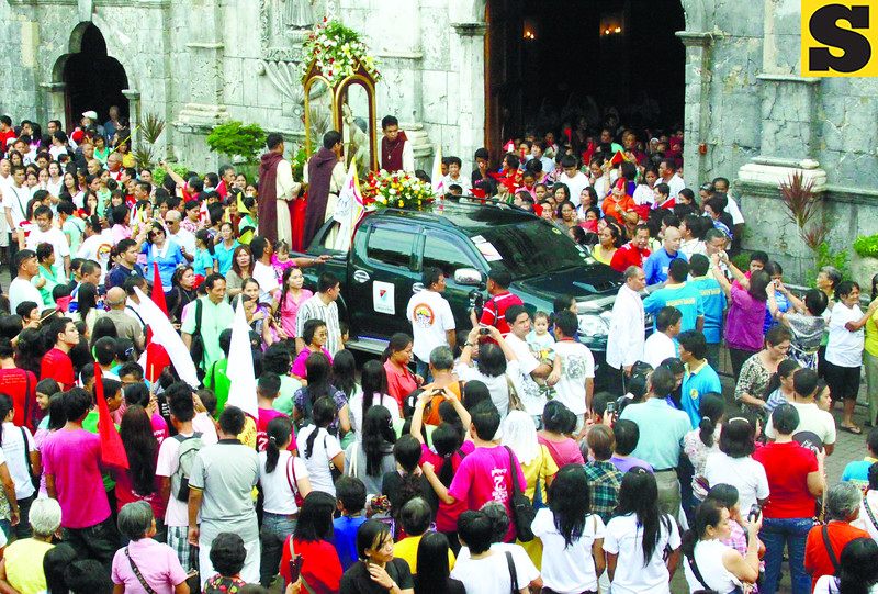 The image of Blessed Pedro Calungsod was carried outside the Basilica del Santo Niño after the mass for the 100 days count down for the canonization day in Vatican. (Sun.Star photo/Alex Badayos)