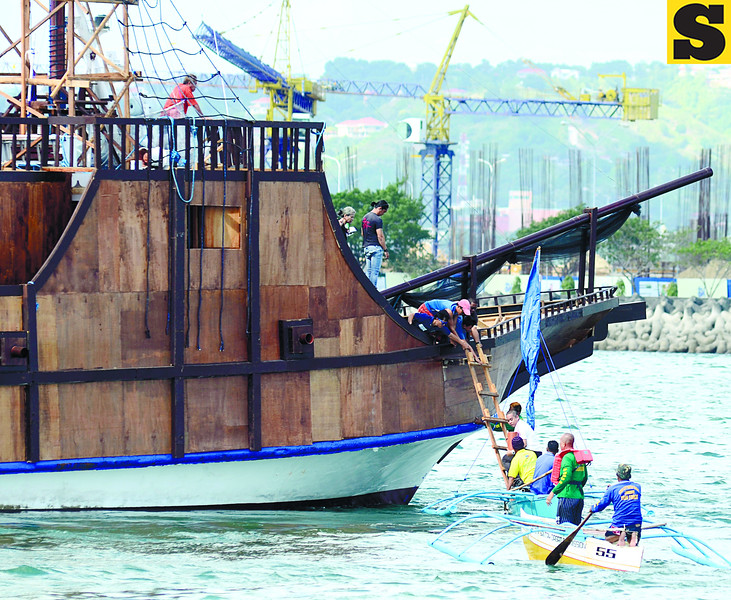 THANKSGIVING. During a rehearsal, Fr. Charles Jayme of the Cebu Archdiocese carries a mock image of Saint Pedro Calungsod from Galleon San Diego to a boat that will carry the image to the SRP, where the Thanksgiving Mass for Calungsod's canonization will be held. (Sun.Star Phto/Amper Campana)