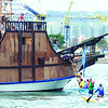 THANKSGIVING.During a rehearsal, Fr. Charles Jayme of the Cebu Archdiocese carries a mock image of Saint Pedro Calungsod from Galleon San Diego to a boat that will carry the image to the SRP, where the Thanksgiving Mass for Calungsod's canonization will be held.(Sun.Star Phto/Amper Campana)