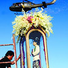 CEBU CITY. A chopper drops flowers and confetti on the crowd below. (Amper Campaña)