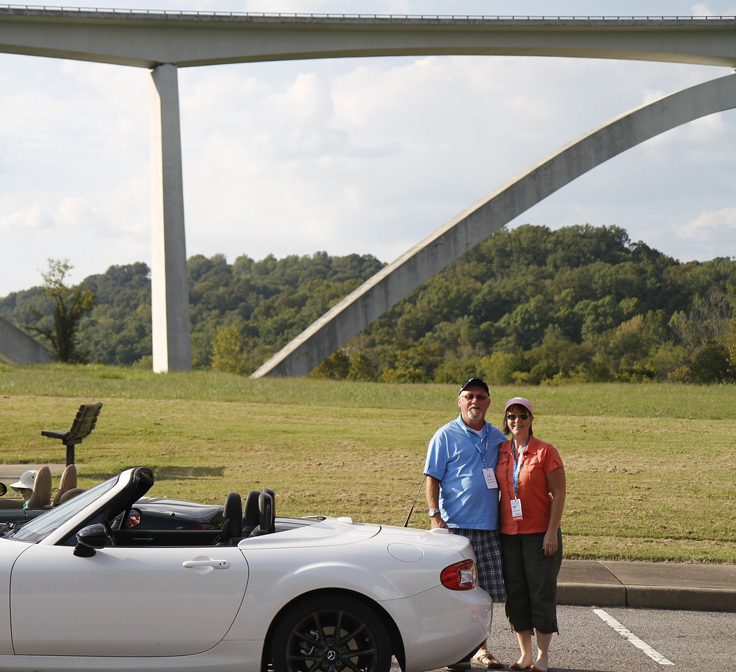 Stan and Karla standing under the Natchez Trace
