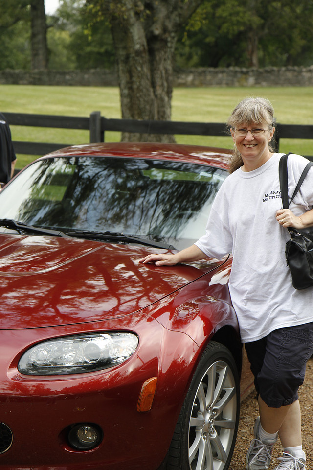 Cyndy standing by our car at Belle Meade Plantation, TN.