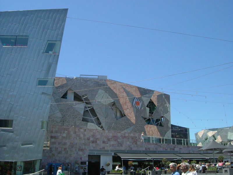 2004-11-12 Melbourne, Australia. Federation Square. The Ian Potter Center that is shown here has a facade created through fractals. The walls are tiled in sandstone, two types of zinc and glass.