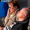 She is at the telephone, he knows it will take a while... Zij is aan de telefoon en hij weet dat het wel even zal duren....
