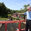Chelmford volunteer George Ripsom Sr., a trustee of the Historic Millstream Foundation, at the mill on Mill Road. (SUN/Julia Malakie)