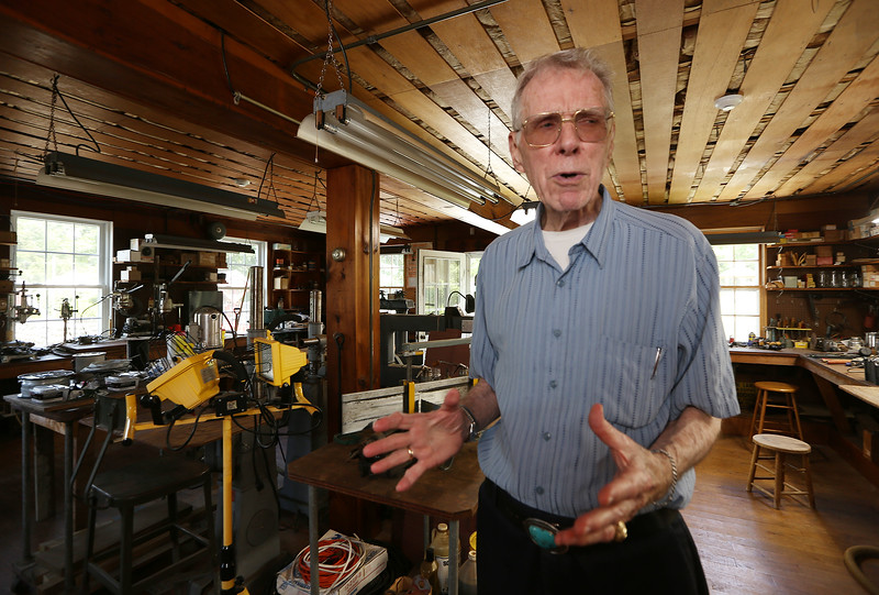 Chelmford volunteer George Ripsom Sr., a trustee of the Historic Millstream Foundation, at the mill on Mill Road. This was part of the former owner's fabrication area for producing phonographs. (SUN/Julia Malakie)