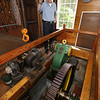 Chelmford volunteer George Ripsom Sr., a trustee of the Historic Millstream Foundation, at the mill on Mill Road. This is Mill Stream Hydro Unit 1, which is driven by the waterwheel outside. The bull gear, which weighs 1500 lbs, transtions the motion of the waterwheel into the generator. (SUN/Julia Malakie)