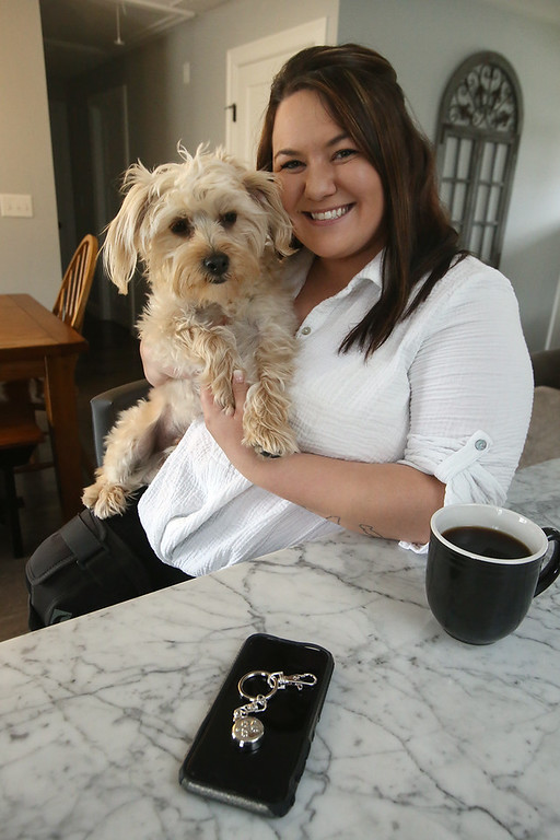. Jenelle Valdina of Chelmsford, who used her invisaWear keychain to get help when she was injured in a car crash on the Lowell Connector. This is her Morkie, Koda, who she called her \'therapy dog.\' Valdina is having physical therapy for her broken leg. (SUN/Julia Malakie)