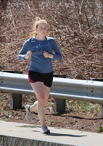 Elizabeth Gabrielson of Chelmsford goes for a run along Parkhurst Road in Chelmsford. She's trying to run 20 minutes a day, and has just begun working remotely. (SUN/Julia Malakie)