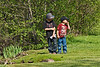 Warning their approaching friends not to scare the geese.<br /> <br /> Part of a sequence of shots of kids braving an approach to some of the Canada geese who are year-round residents.  The boys scared themselves more than the geese scared them I'd say.<br /> <br /> Gallup Park, Ann Arbor<br /> April 19, 2012<br /> (nex5n)