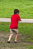 The Thrill of the Chase #3<br /> This boy was chasing a chipmunk (with no hope of catching it).  His body language was so expressive.<br /> <br /> Gallup Park, Ann Arbor<br /> April 19, 2012<br /> (nex5n)