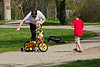 Here comes the other pair of brothers.  Trouble is brewing.<br /> <br /> Part of a sequence of shots of kids braving an approach to some of the Canada geese who are year-round residents.  The boys scared themselves more than the geese scared them I'd say.<br /> <br /> Gallup Park, Ann Arbor<br /> April 19, 2012<br /> (nex5n)