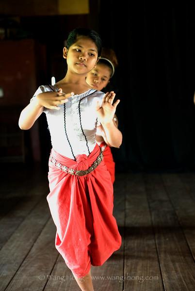 Girl learning classic Kmer dance at Apsara Art Association in Phnom Penh - very elegant posture