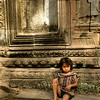 Little girl idling at Ta Prohm, very much part of the scene.