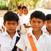 School boys gathering for picture on our way to Angkor Borei