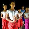 Girl learning classic Kmer dance at Apsara Art Association in Phnom Penh - very elegant posture.