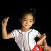 Little girl learning classic Kmer dance at Apsara Art Association in Phnom Penh - posing for picture.