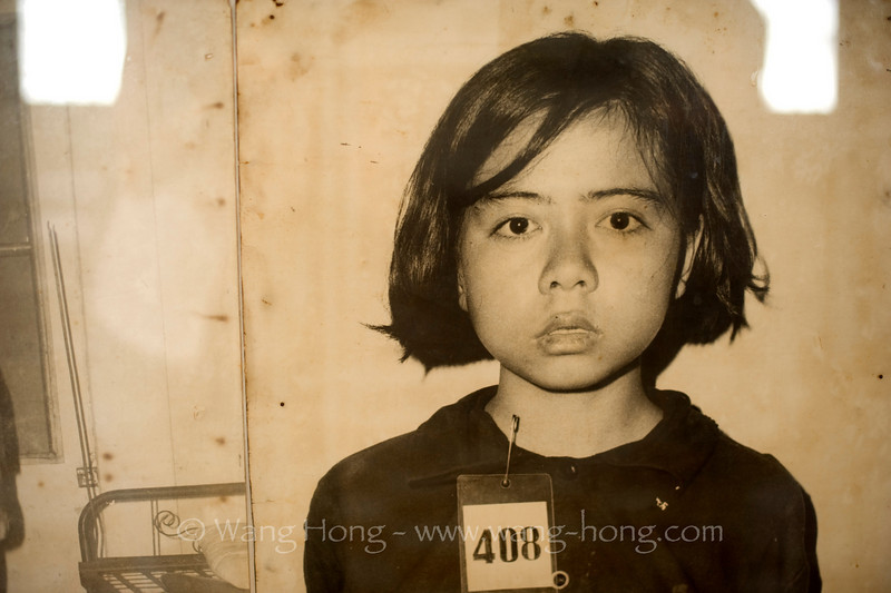 Little girl's photo exhibited at the Kmer Rouge Genocide Musuem in Phnom Penh, the most depressing exhibition I have ever been to.