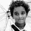Girl walking with an umbrella in Mirissa, Sri Lanka.