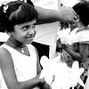 Girl coming to Ruwanwelisaya Stupa with lotus flowers to worship in Anuradhapura, Sri Lanka.