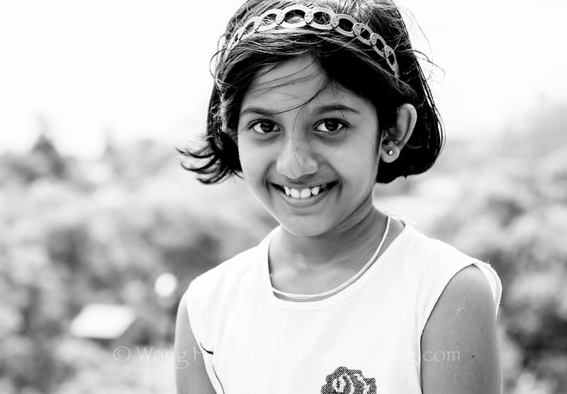Girl visiting the ancient city of Anuradhapura with her mom, Sri Lanka.