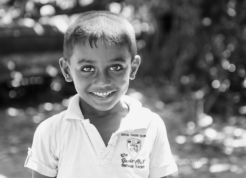 Boy playing on Mirissa Beach, Sri Lanka.