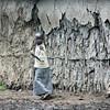 Masai Girl by a Hut