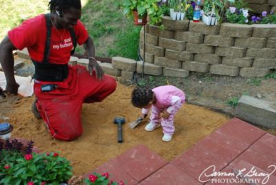Helping Daddy pave Aunt Carmen's backyard...Im a good helper ..aren't I daddy!?