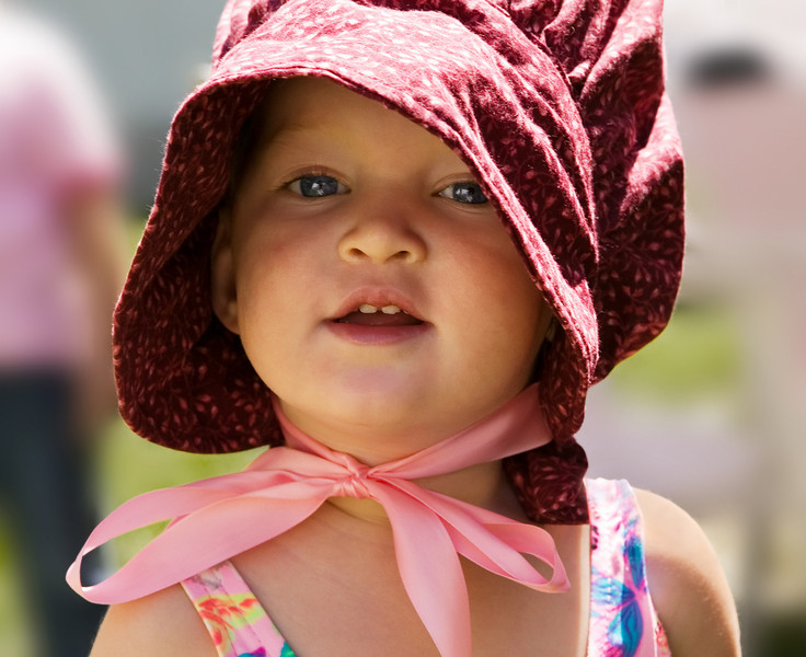 """Portrait of cute little girl in old-fashioned 'pioneer' bonnet. Click the """"Buy"""" or shopping cart button (above the image) to purchase prints or downloads. (To purchase prints or downloads, click on the """"Buy"""" or shopping cart button above the image; then choose """"This Photo"""", followed by clicking on the 'Prints', 'Merchandise', or 'Downloads' tab.)"""