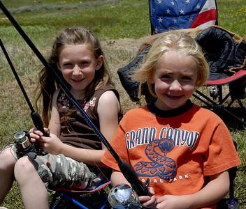 Amanda Carter (L) and Riley Burk (R), both 6 yrs-old, of Lehi at Benches Reservoir on Wasatch Plateau.  Photo taken in summer 2007 by Brent Stettler, Utah Division of Wildlife Resources.
