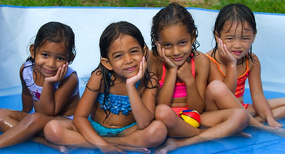 Girl friends in pool. Belize City, Belize.