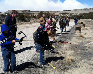 Youth take aim at the family archery clinic at North Springs Shooting Range. Photo take 3-23-13 by Brent Stettler, Utah Division of Wildlife Resources.