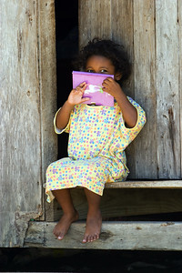 Little girl on the steps of her house in Seine Bight, Stann Creek.